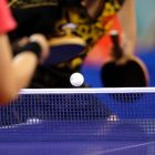 Guo Yue from China, background, returns a ball to Li Jia Wei from Singapore during their women's table tennis bronze medal match at the Beijing 2008 Olympics in China Friday, Aug. 22, 2008. China won the bronze. (AP Photo/Petr David Josek)